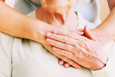 Young female hands hugging old woman, closeup. Giving support during body donation