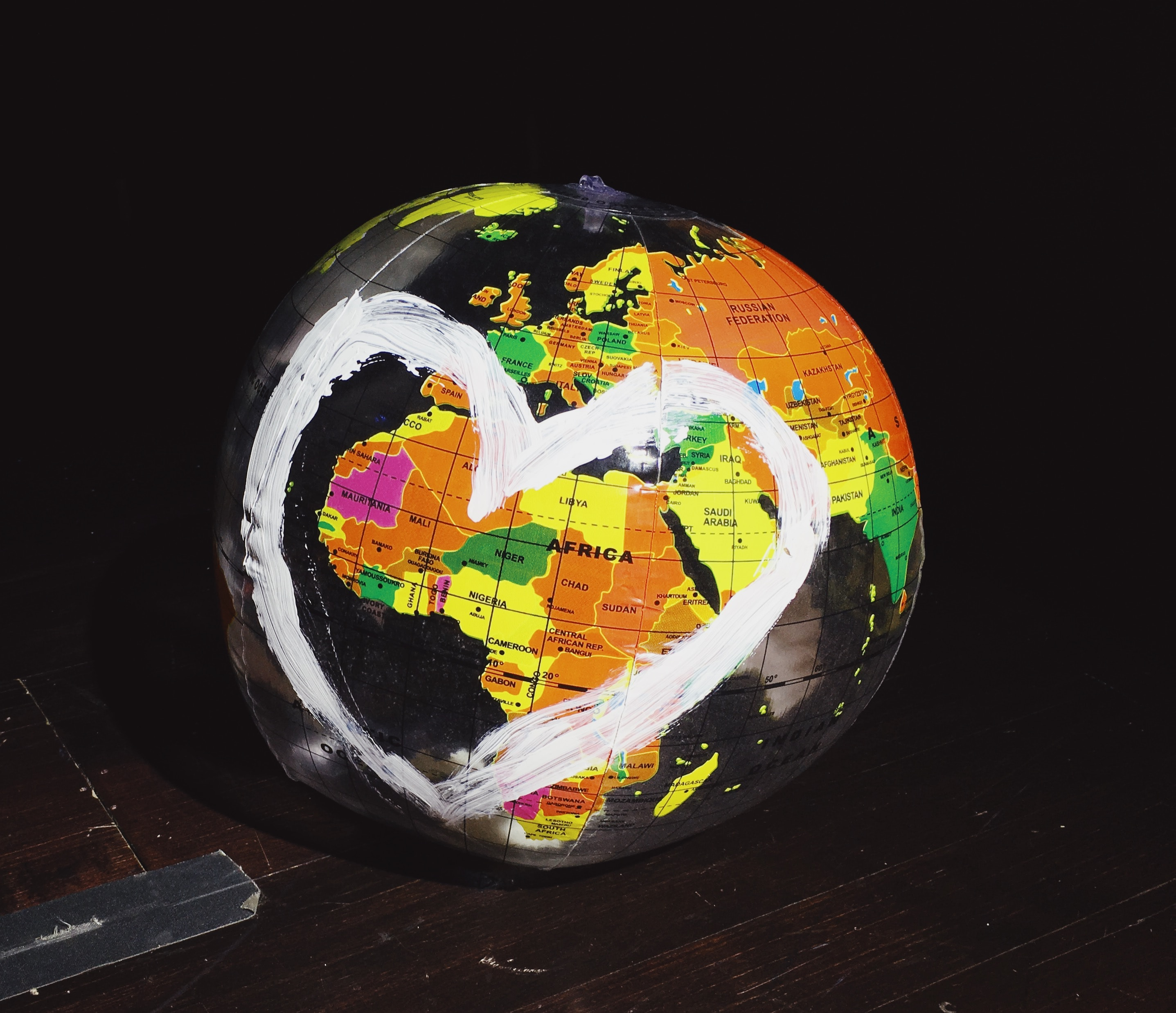 Globe with a heart painted on it, representing the compassion that goes into MedCure's pacemaker recycling program