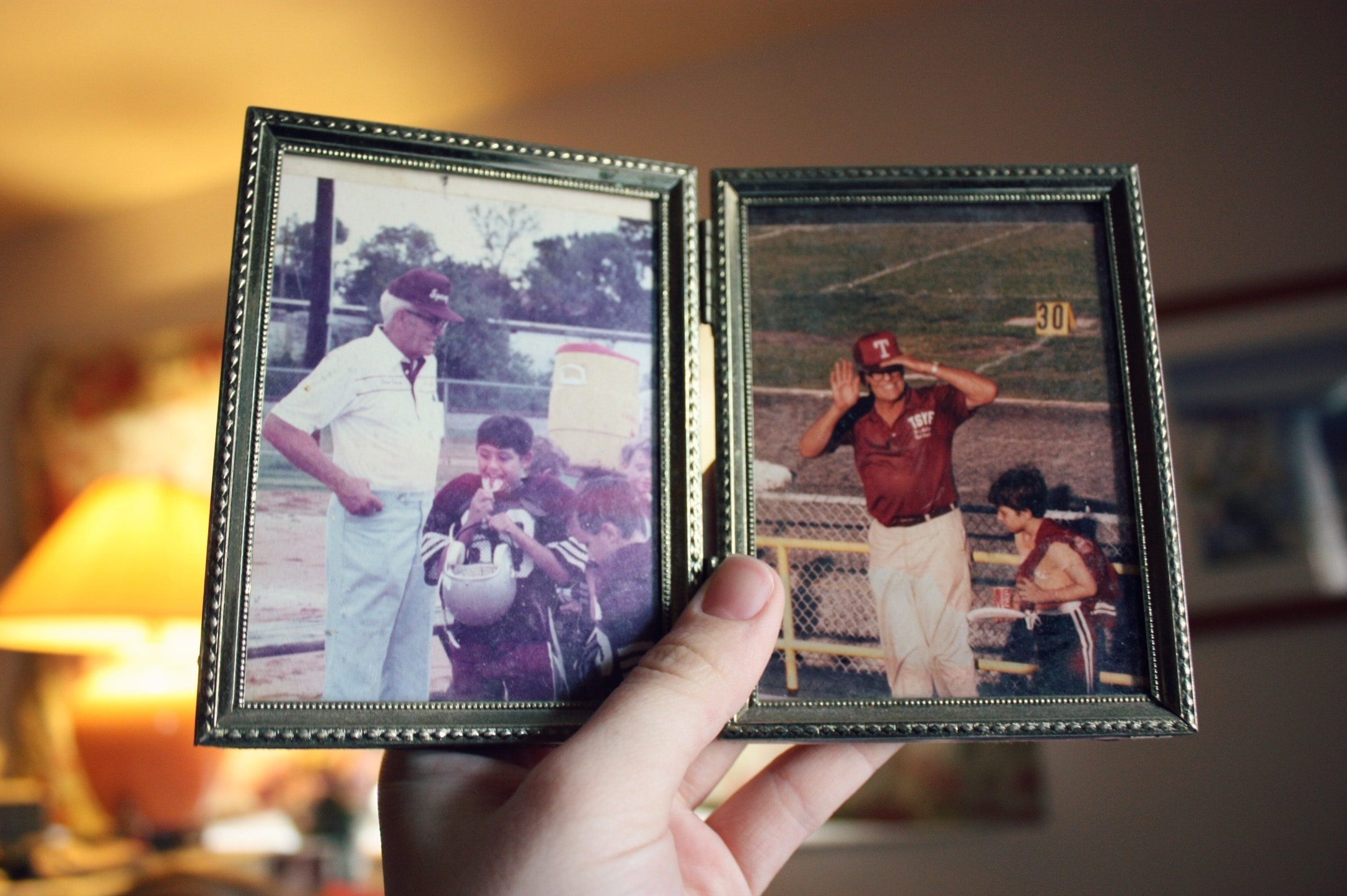 Person Holding Old Family Photos