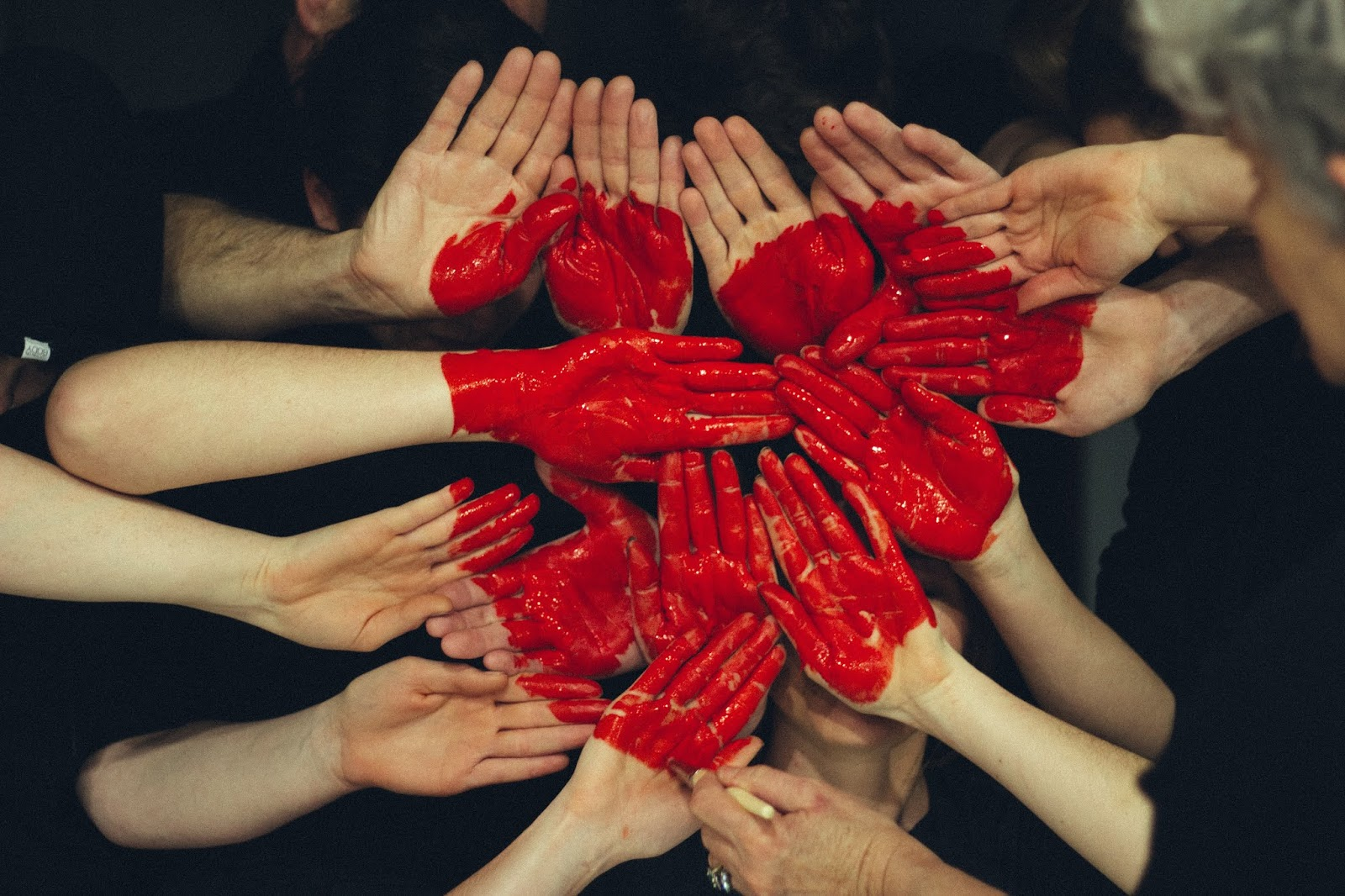 Many hands coming together to make a heart, symbolic of the gift of whole body donation